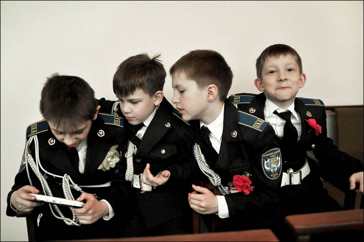 Boys cadets playing video game