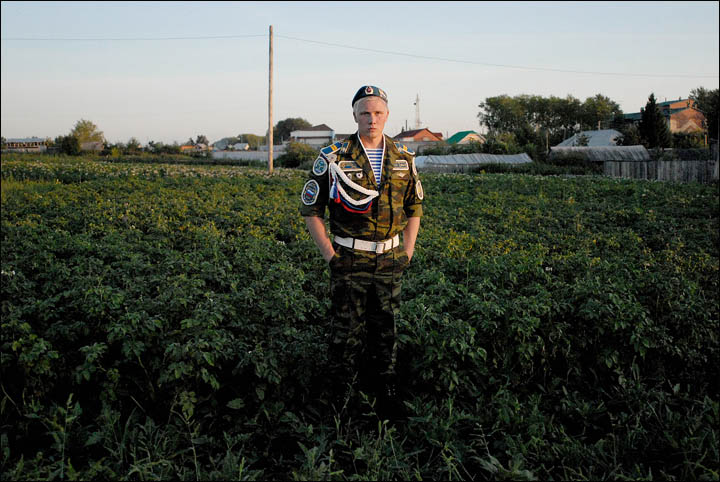 Soldier at potatoes field