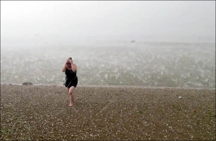 Novosibirsk hail storm woman coming out the water