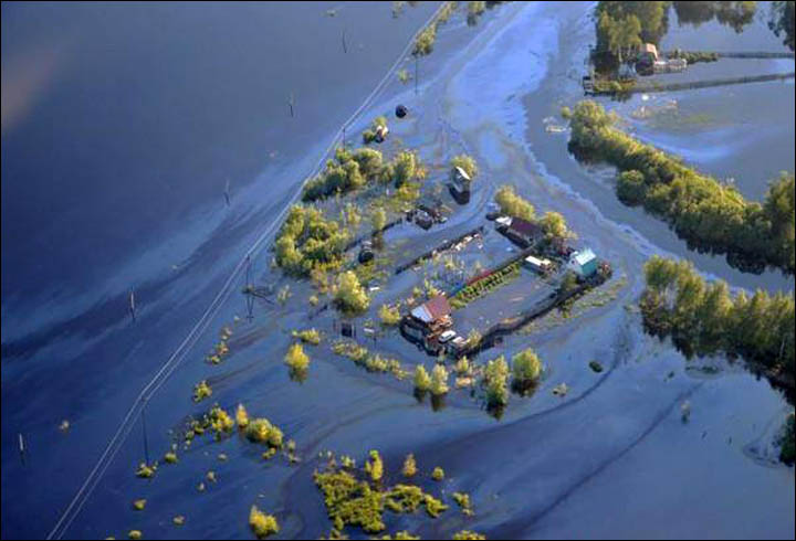 Oil Sheen on Floodwaters from Russian Oil Spill 2015