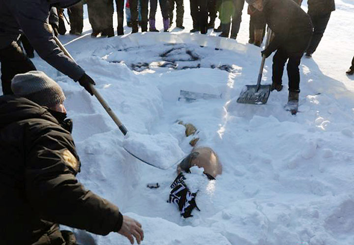 Oleg being buried