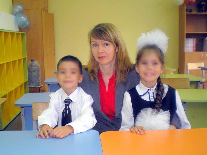 Oleg's wife Irina with kids
