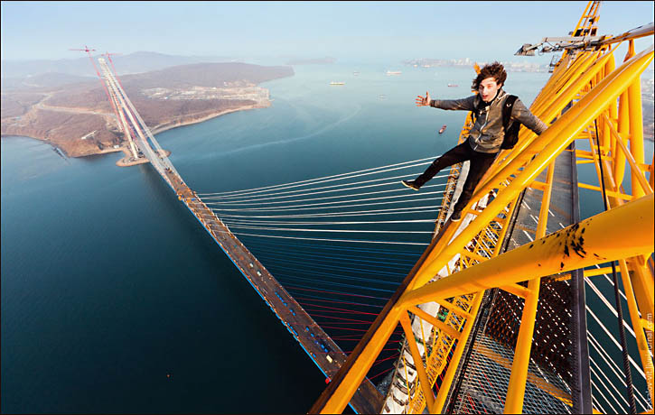 Vitaliy Raskalov stands atop Golden Horn bridge in Vladivostok