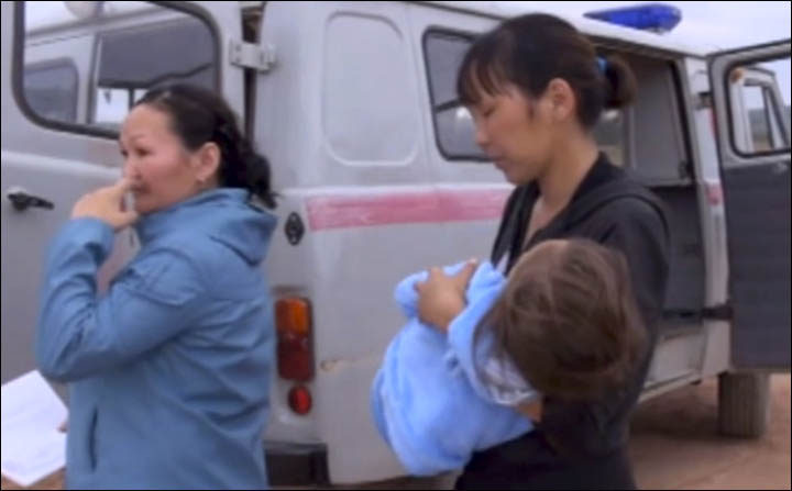Karina carried to the car of rescuers