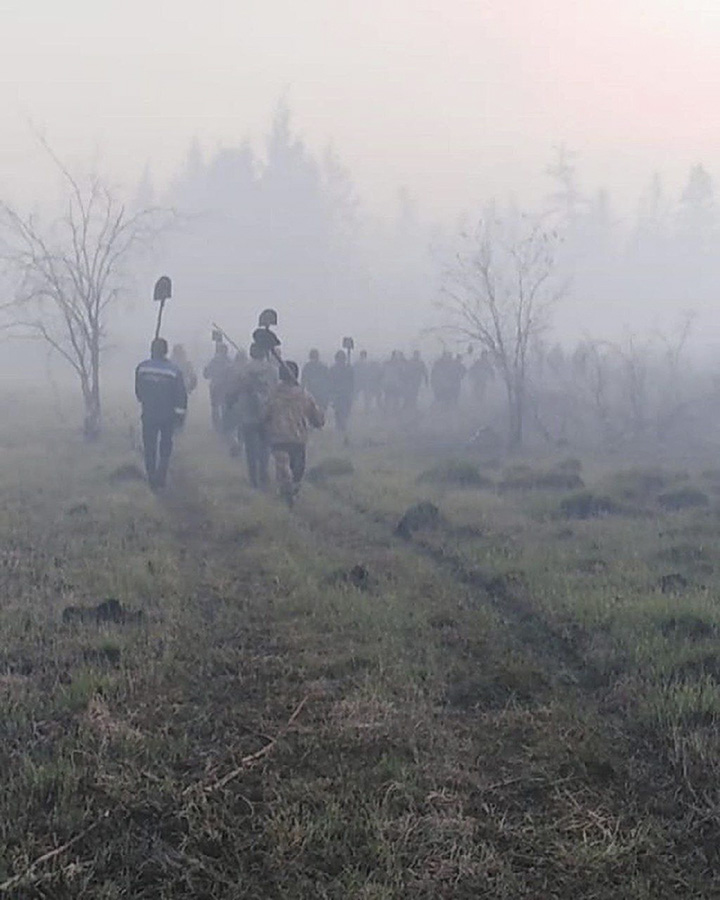 Volunteer firefighters go into the forest