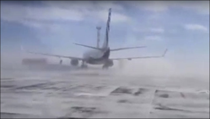 Plane being blown