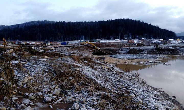 Dam failure kills at least 11 at Siberian gold mine