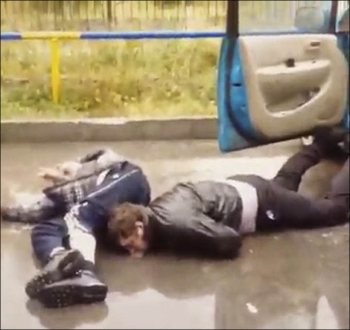 Two men are lying on the ground