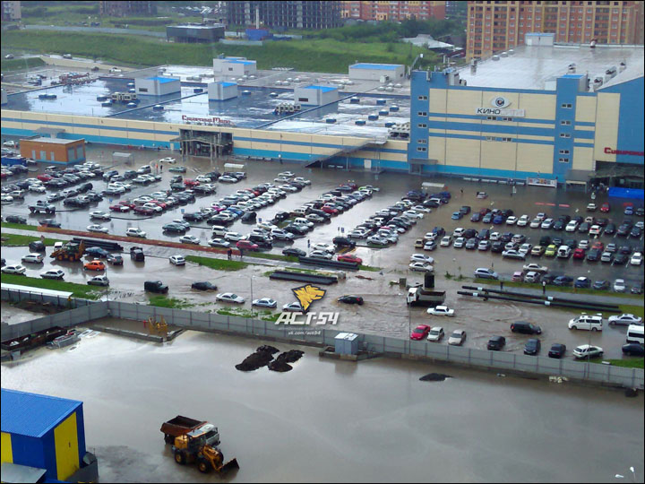 Deluge hits Siberia's largest city, causing 'waterfall' near city's railway station