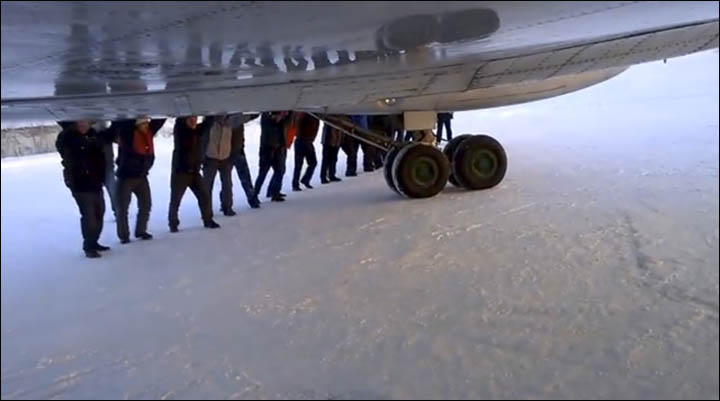 Men pushing aircraft