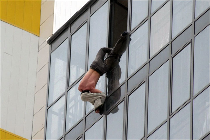 Man hanging in the window