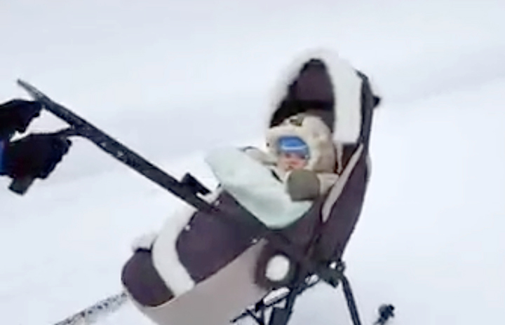 Skiing into shape - applause for video showing young mother's bikini run with her baby