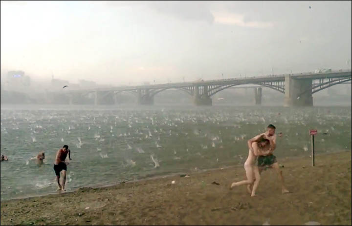 Freak hail storm hits Siberian beach in mid-summer - extraordinary pictures