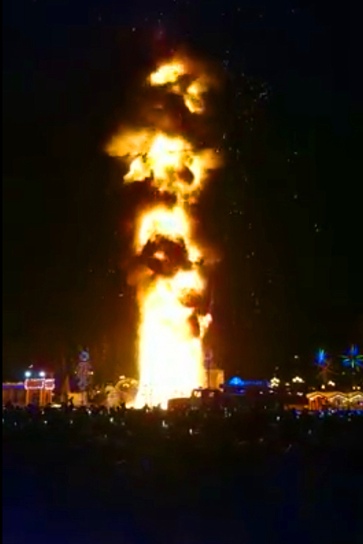 Festive tree erupts in flames as several thousand mark New Year celebration