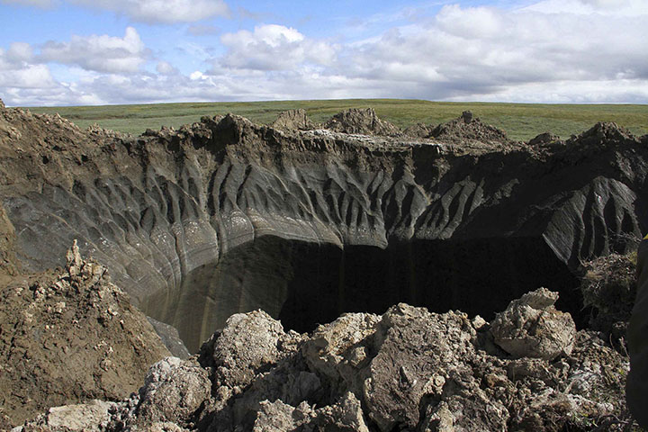 Giant new 50-metre deep crater opens up after explosion in Arctic tundra