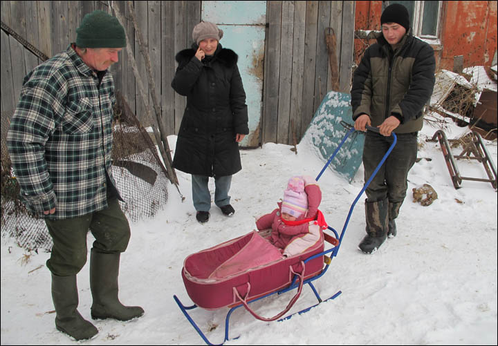 British baby enjoys her first sleigh rides in remote Siberian village where she is being raised