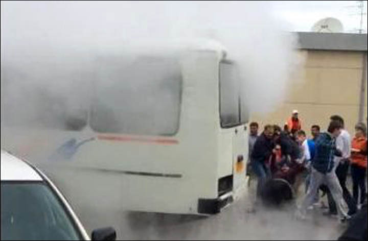 Packed minibus filled with boiling water after 'geyser' bursts through Siberian street