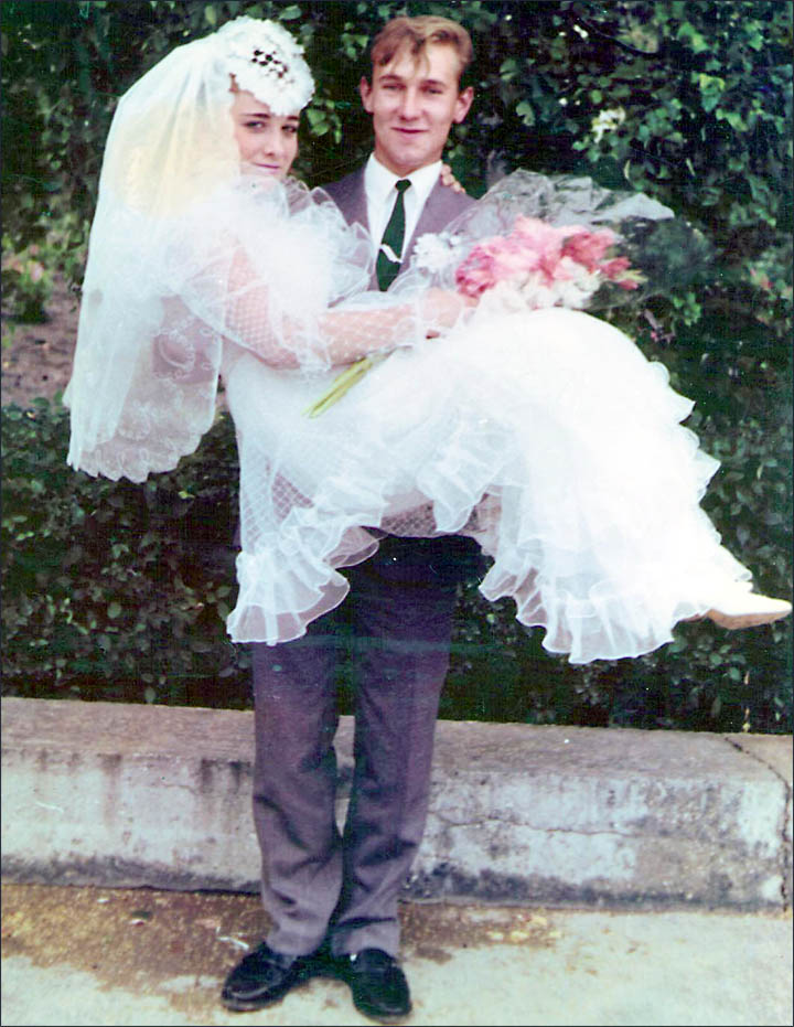 Olga Kurochkina with her husband on their wedding day