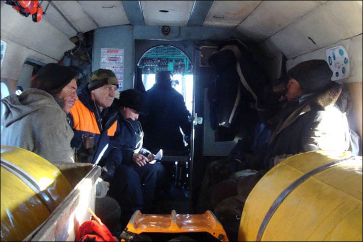 fishermen inside the helicopter