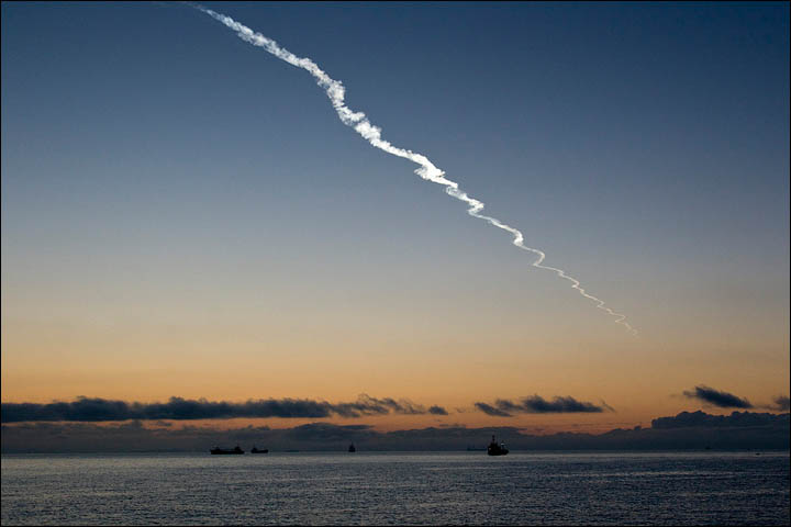 Or was it a meteor lighting up the early morning sky over the Pacific port?