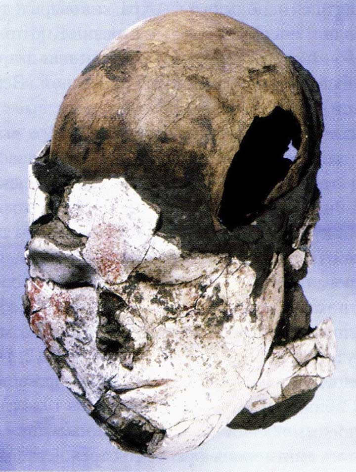 Head with clay modeled face