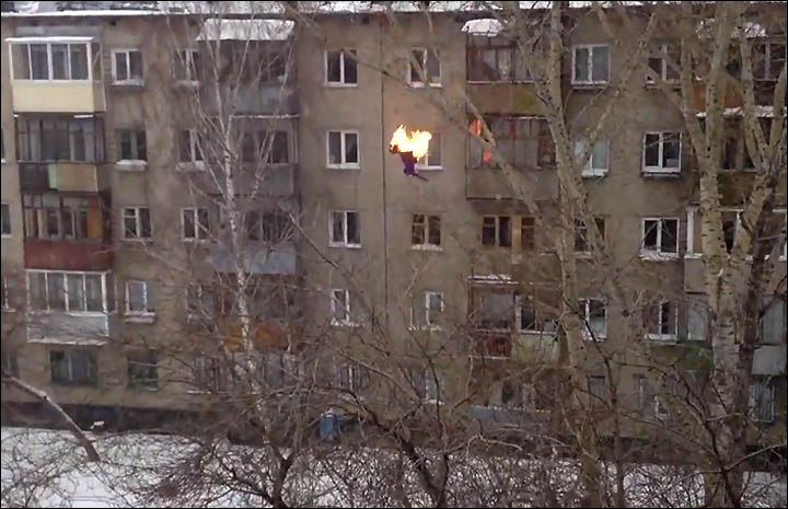 Teenager is set on fire before diving five floors into pile of snow.