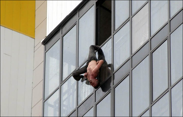 Hanging Pictures rescue for man hanging perilouslyone leg out of 15th floor window